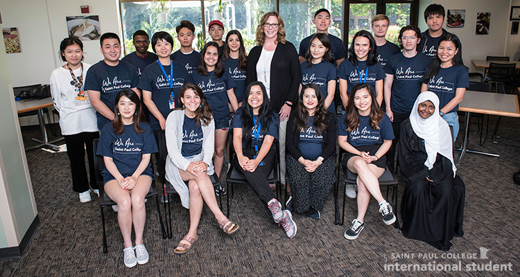 Photo of international students with Saint Paul College Interim President Deidra Peaslee